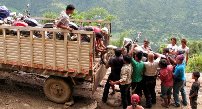 Motorcycles get loaded on the 4x4 truck near Sindhupalchowk, Nepal